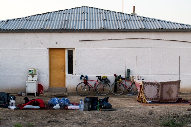 We couldn't quite make it to Nukus so we spoke to one of the locals who ended up sending us to this family to stay with them. We woke up outside sleeping alongside the family in their mosquito net.