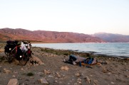 Sleeping on the tarpaulin under the stars next to lake Toktugul, Kyrgyzstan.
