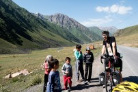 Kids are always the most inquisitive of the strange bearded monsters who for some reason are cycling uphill... 2500m elevation. Kyrgyzstan.