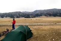 Camping alongside Sayram Lake. Probably the last of the yurts we'll see on the trip. It's cold and we didn't really sleep because the wind was horrendous. Sayram Lake, Xinjiang, China.