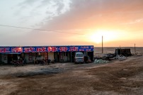The dust out in the desert produces some incredible colours at sunset. We found this little restaurant in the middle of nowhere to give us some noodles. East of Kumul, Xinjiang, China