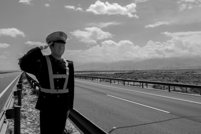 Someone obviously thinks motorists will find it believable that a lone policeman is standing in the middle of a dual carriageway out in the desert, miles from anything. It certainly caused me to slow down I suppose. SE of Jiuquan, Gansu, China.
