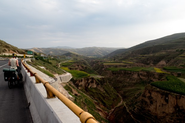 Stunning views from the bridges the Chinese have built straight through these valleys. Near Dingxi, Gansu, China.