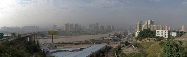 Lanzhou. Ranked one of the 30 most polluted cities on the planet. Best to keep moving and get out the other side. Lanzhou, Gansu, China.