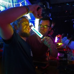 """Fighting Dr McVicar with a """"lightsaber"""". Trying to fit into the weirdness around us. Robot Restaurant, Shinjuku, Tokyo, Japan"""