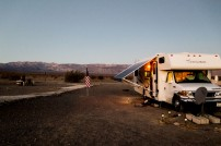 Sleeping under the stars just below sea level. Love the American flag outside this RV. Reece grinding coffee beans in the background to get us on our way for sunrise. Stovepipe Wells, Death Valley, CA, USA