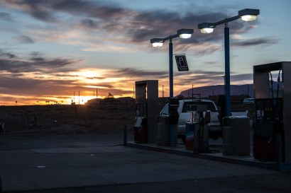 Another great sunrise, overshadowed by the steel sign flapping at 45degrees telling us we've got another day of strong headwinds. Red Mesa, AZ, USA